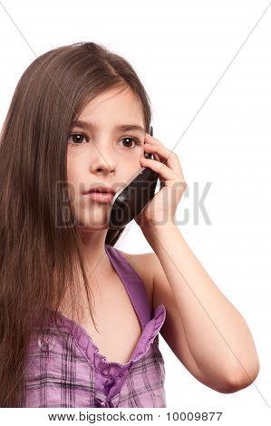 Portrait of a little girl speaking on cellphone