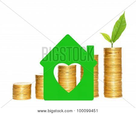 Columns Of Gold Coins And Green House Symbol Over White Background