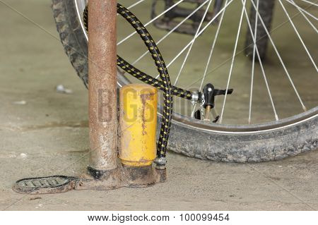 Old Air Pump And Bicycle Tire.