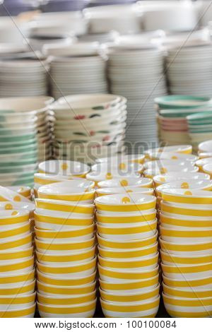 Stack Of Yellow Bowl In Warehouse.