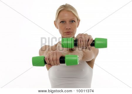 portrait of a young caucasian woman who trains with dumbbells in hand