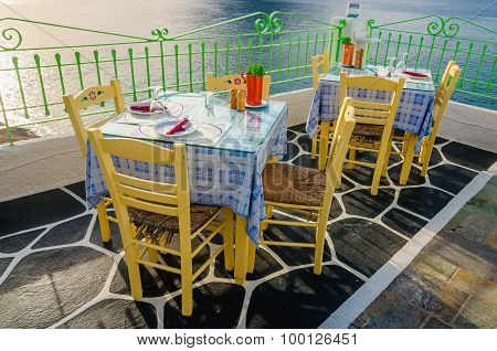 Tables at restaurant with national Greek colors