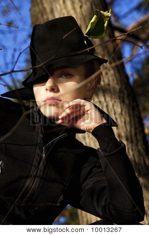 Beautiful Young Woman In A Stylish Black Hat