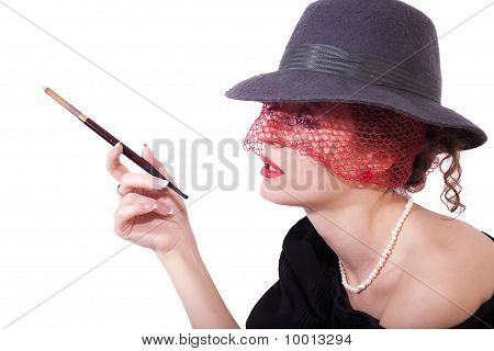 Young Woman In A Hat And Veil With Cigarette