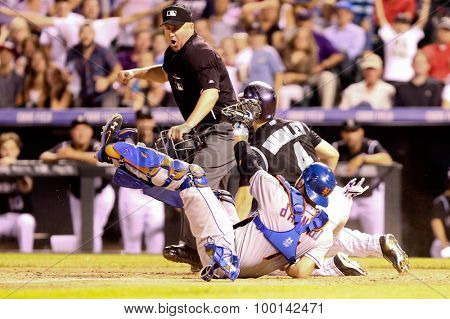 DENVER-AUG 21: New York Mets catcher Travis d'Arnaud tags out Colorado Rockies catcher Nick Hundley during a game at Coors Field on August 21, 2015 in Denver, Colorado.