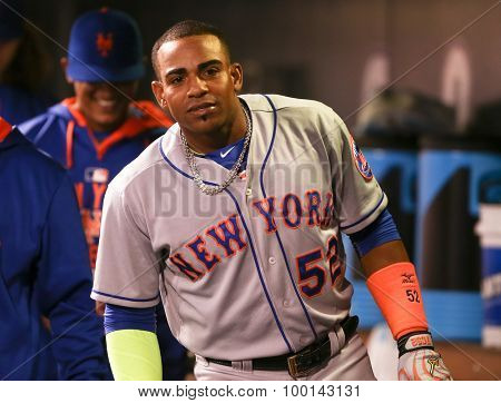 DENVER-AUG 21: New York Mets outfielder Yoenis Cespedes celebrates in the dugout after hitting a homerun against the Colorado Rockies at Coors Field on August 21, 2015 in Denver, Colorado.