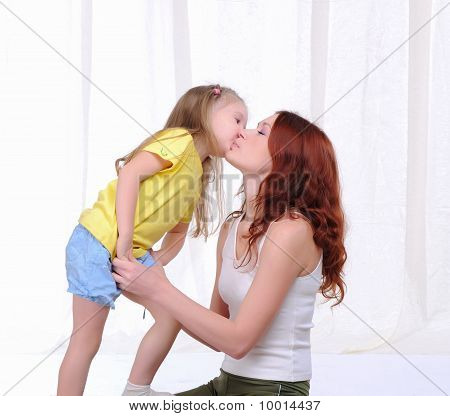 Little Girl Lovingly Kisses