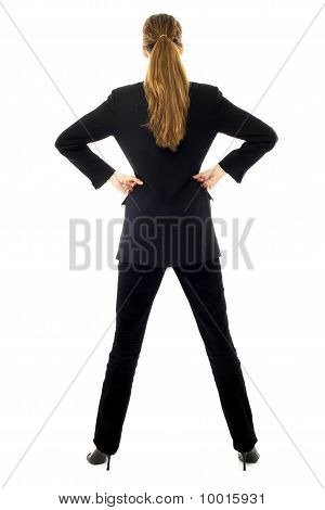 Young businesswoman standing back on white background studio