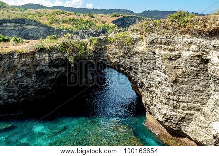 tunnel crater coastline at Nusa Penida island near Pasih Uug (Broken Beach) Bali Indonesia poster
