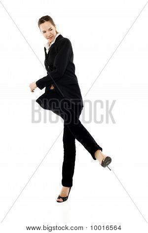 young businesswoman kicking on white background studio