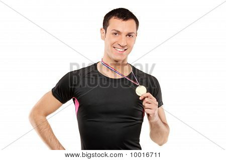 Young Smiling Sportsman Holding A Gold Medal