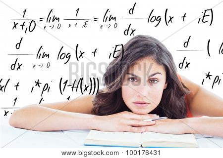 Frowning student head on her books against maths equation poster