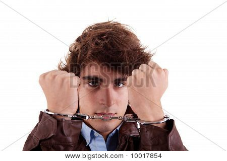 Arms On The Face, Of A Young Man, With A Handcuffs On The Hands, Isolated On White Background