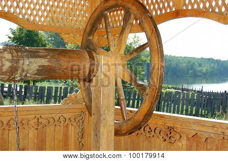 Carved wooden tower over the well at lake Igjboolat . detail, circumstance