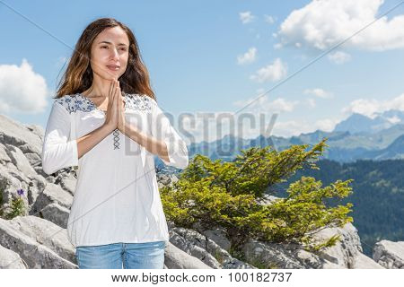 Woman Meditating Ouutdoors In Summer