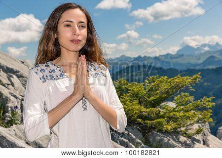 Yogi Woman Meditating Outdoors In Nature