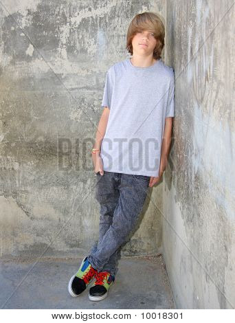 Teen Leaning On Wall