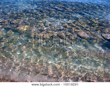 Lake Stones in Transparent, Clean Shades of Blue Waters