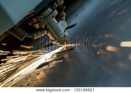 Laser cutting of metal sheet, close-up