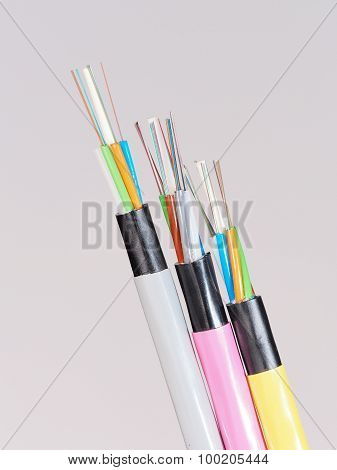 Different colored fiber optic cable ends with stripped jacket layers