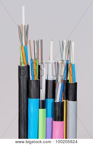 Group of 7 different fiber optic cable  ends with stripped jacket layers