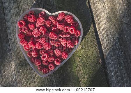 Raspberries In A Bowl On Wood