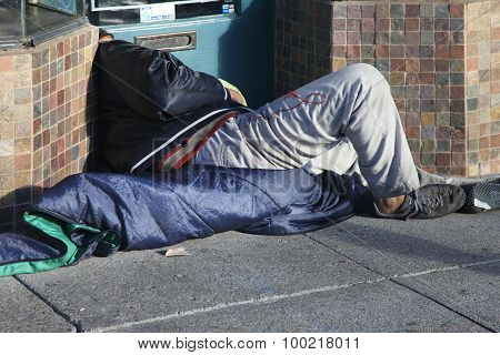 Homeless Man Sleeps On The Street