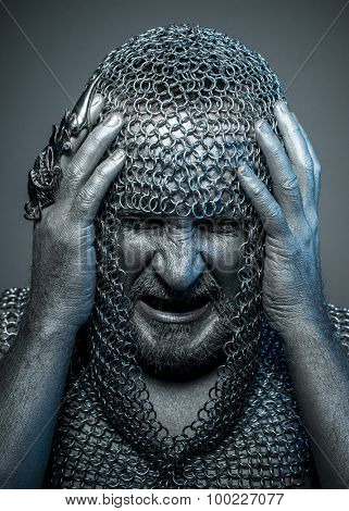 Scary, medieval executioner mesh iron rings on the head