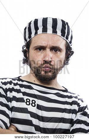 Illegal, Desperate, portrait of a man prisoner in prison garb, over white background