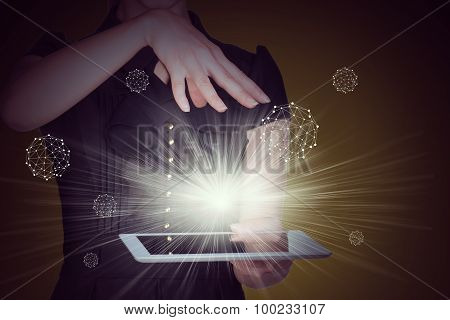 Businesslady with tablet and spotlight