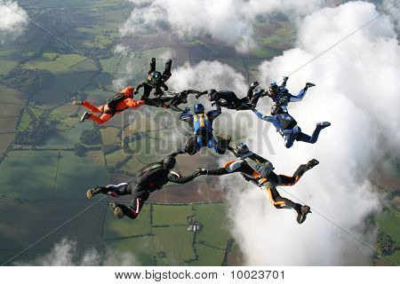 Nine skydivers in freefall