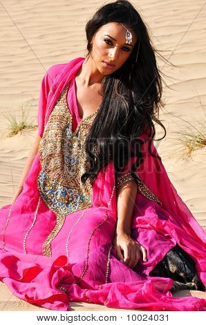 Beautiful Sexy Lady In Pink Oriental Dress In Arabic Desert