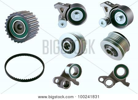 Rubber PV, gear belts and rollers for the car engine on a white background