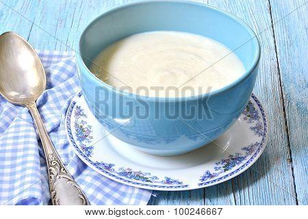 Semolina Porridge On The Wooden Table.