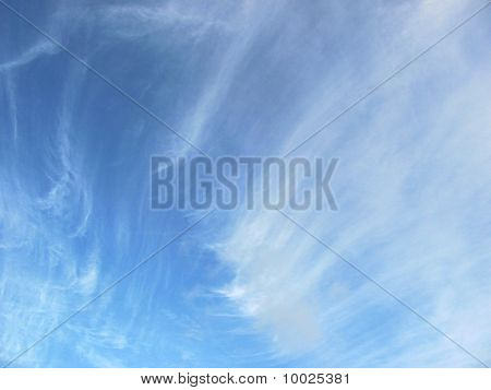 feathery clouds of the Azorean sky