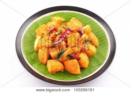 Tasty and spicy south Indian idly dish on banana leaf. poster