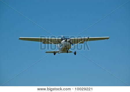 Small Aircraft In Flight With Blue Sky