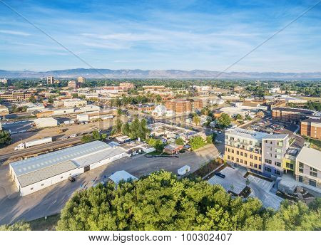 aerial view of Fort Collins downtown with Front Range of Rocky Mountains on horizon, late summer
