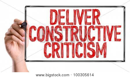 Hand with marker writing the word Deliver Constructive Criticism