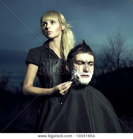 Barber Shaves Client