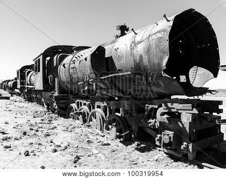 Rusty locomotive in train cemetery near Uyuni