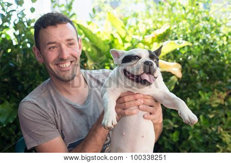 Man Holding His Dog