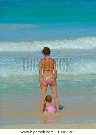 Women With Baby Beside Her Legs