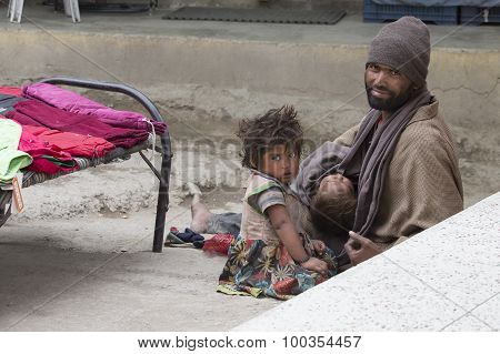 Indian Beggar Man With Children On The Street In Leh, Ladakh. India