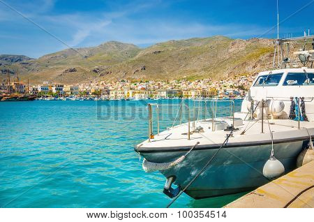 Small speed boat moored on clear water, Greece