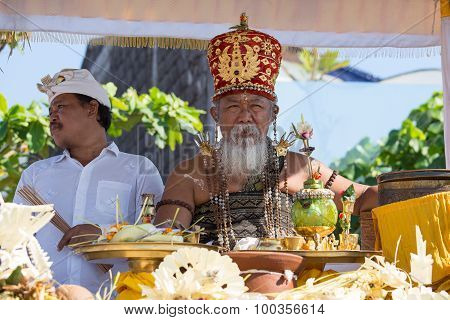 Old Brahmin Conducts Religious Ritual On The Beach Ketewel. Bali, Indonesia