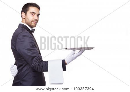 Handsome waiter holding an empty silver tray, isolated on white background