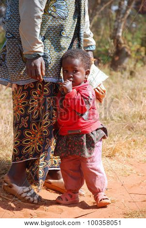 An African Woman With Her Children 10
