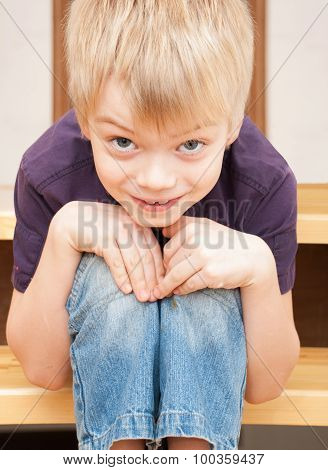 Amusing Boy Sits On A Ladder