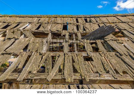 An old roof of a house in disrepair.